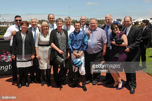 Owners of Electric Tribute after winning Café Adamo Handicap at Flemington Racecourse on December 10 2016 in Flemington Australia
