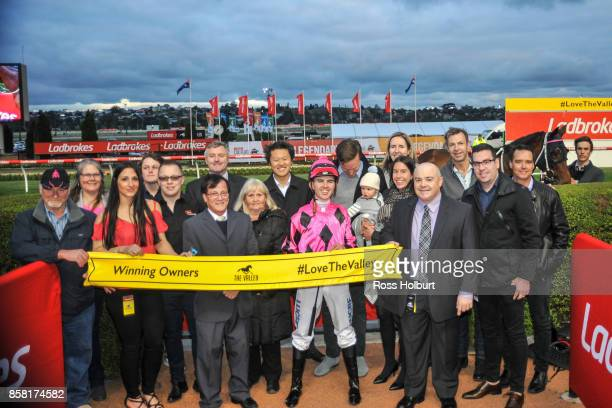 Owners of Kawabata after winning the TSOLS TIPS Handicap at Moonee Valley Racecourse on October 06 2017 in Moonee Ponds Australia