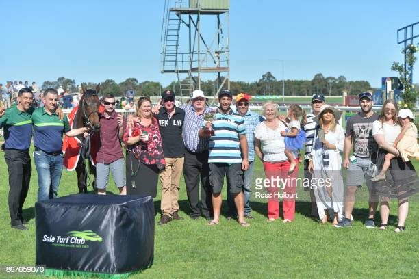 Owners of Moss 'n' Dale after winning the Ladbrokes Sale Cup at Sale Racecourse on October 29 2017 in Sale Australia