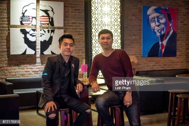 Owners of the 5month old bar named after US President Donald Trump Nguyen Ha Anh Tuan 32 right and Huynh Nhat Quang 30 left pose for a portrait...