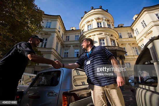 Owners of the Trabantbrand cars shake hands as they arrive at a commemoration event to the 25th anniversary of refugee exodus from communist East...