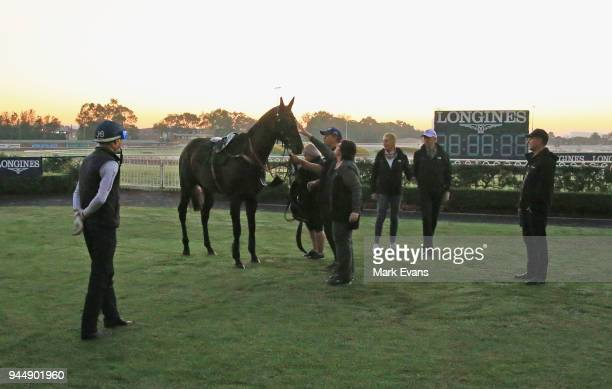 Owners of Winx inspect the horse as Hugh Bowman and Chris Waller look on after a trackwork sesskion at Rosehill Gardens on April 12 2018 in Sydney...