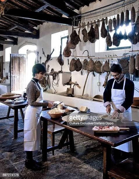 Owners preparing lunch, Agriturismo Testone, Sa Serra, Nuoro, Sardinia, Italy