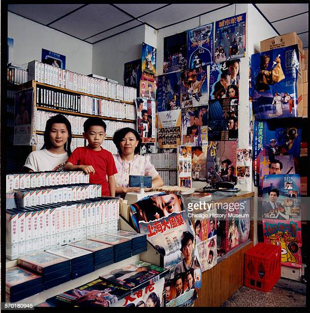 Owners standing in their Asian video store in Chicago Illinois 1987