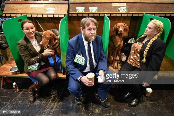 Owners wait to show their Vizsla's on day 2 of the Cruft's dog show at the NEC Arena on March 6, 2020 in Birmingham, England. The annual four-day...
