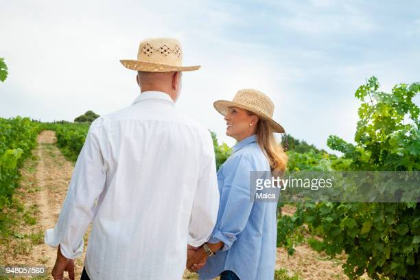 Owners walking through their vineyards