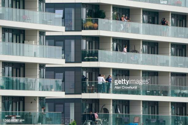 Owners watch the action from their apartments that are located on the course at Newbury Racecourse on August 15 2020 in Newbury England Owners are...