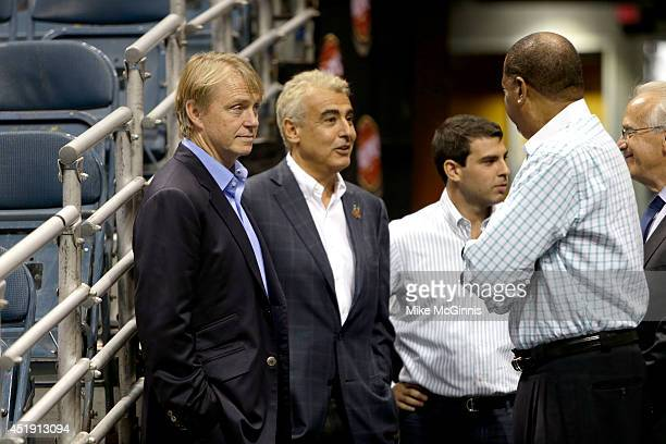 Owners Wesley Edens Marc Lasry await for the official announcement of their new head coach Jason Kidd to the Milwaukee Bucks at BMO Harris Bradley...