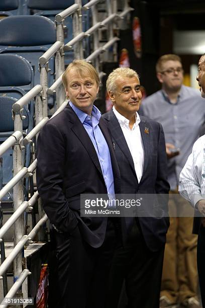 Owners Wesley Edens Marc Lasry await the announcement of their new head coach Jason Kidd to the Milwaukee Bucks at BMO Harris Bradley Center on July...