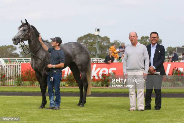 Owners with Sneakers after winning the Elvis Ricky Thurgood Handicap at Ladbrokes Park Lakeside Racecourse on April 17 2017 in Springvale Australia