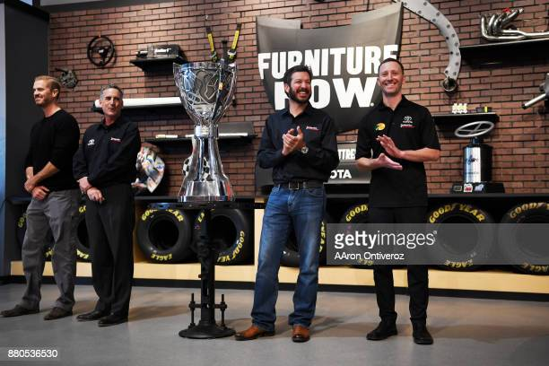 Ownership representation Dan Visser team president Joe Garone driver Martin Truex Jr and crew chief Cole Pearn of Furniture Row Racing celebrate the...