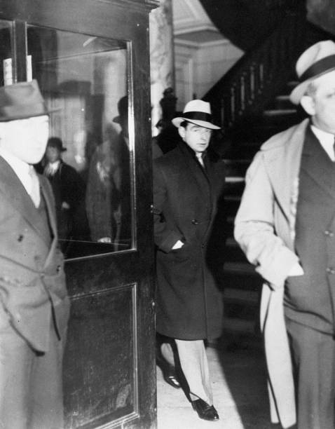 Owney madden entering police headquarters after he surrendered to police when the parole board announced he
