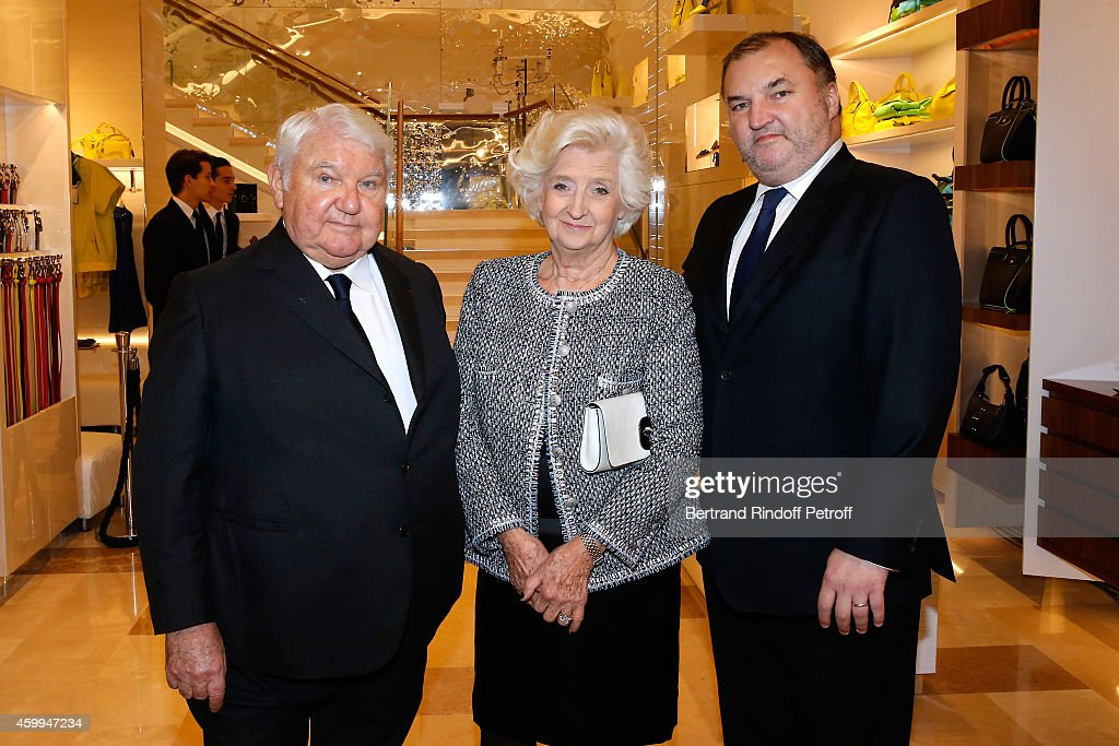Ownr of Longchamp Philippe Cassegrain, his wife Michele Cassegrain and their son US Head of Retail Olivier Cassegrain attend the Longchamp Elysees 'Lights On Party' Boutique Launch on December 4, 2014 in Paris, France.
