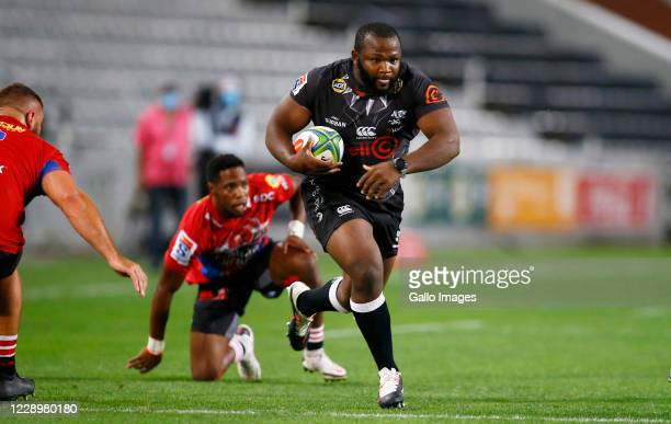 Ox Nche of the Cell C Sharks runs with the ball during the Super Rugby Unlocked match between Cell C Sharks and Emirates Lions at Jonsson Kings Park...