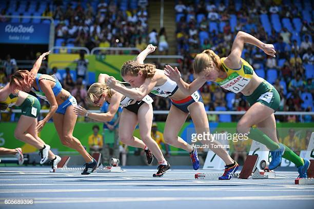 Oxana Corso of Italy Uta Streckert of Germany Maria Lyle of Great Britain and Isis Holt of Australia compete in the Women's 100m T35 final on day 7...