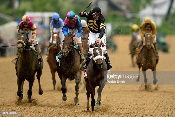 Oxbow ridden by Gary Stevens leads the field to the finish line to win the 138th running of the Preakness Stakes at Pimlico Race Course on May 18...