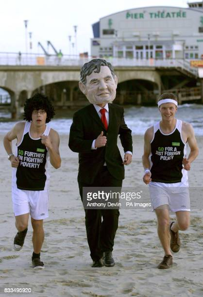 Oxfam campaigners wearing running gear and dressed as Prime Minister Gordon Brown on Bournemouth beach Dorset