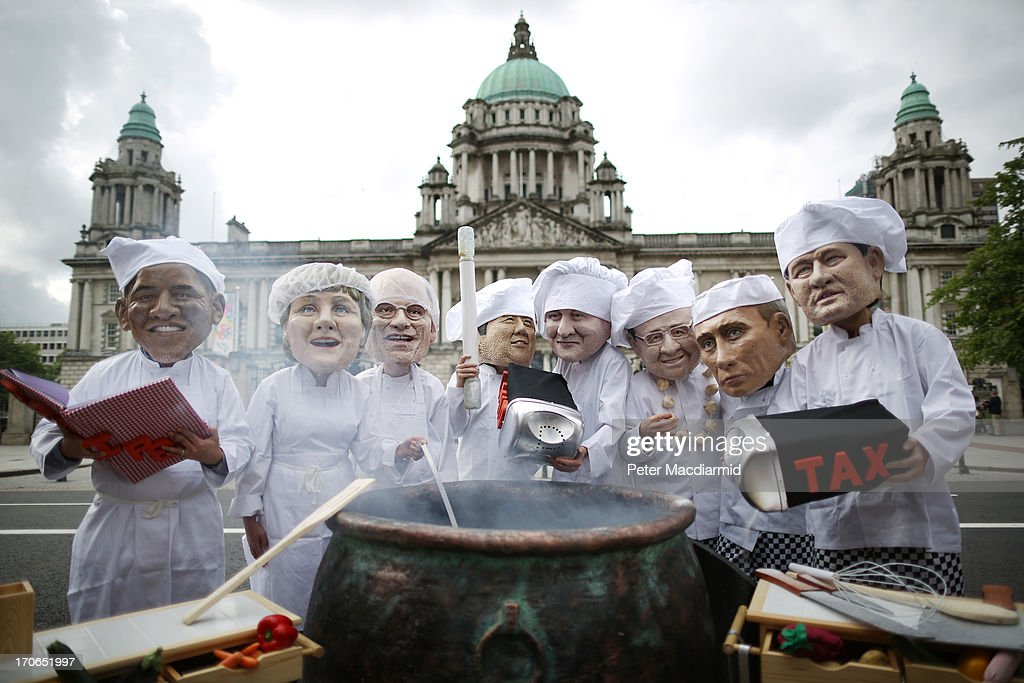 Oxfam charity volunteers wear masks depicting the G8 leaders during a photocall outside City Hall on June 16, 2013 in Belfast, Northern Ireland. The G8 group of world leaders will meet tomorrow in Fermanagh, Northern Ireland.