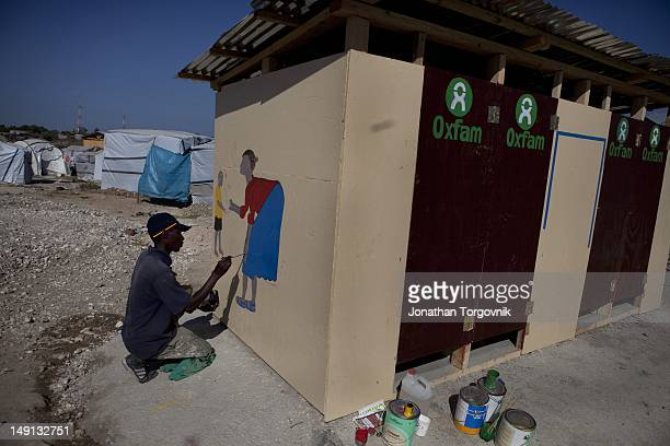 Oxfam sanitation project in one of the tent camps They hire local artists to hand paint their logo and paint images that can be used for education...