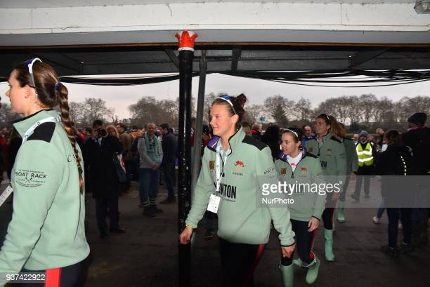 Oxford and Cambridge University Women Boat Club pose next to trophy before The Cancer Research UK Womens Boat Race in Putney London on March 24 2018