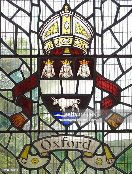 Oxford crest with a bull and mitre in a stained glass window at Hughenden Manor England Hughenden is closely associated with the former Prime...