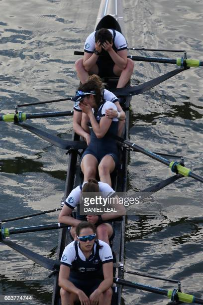 Oxford crew members Alice Roberts Flo Pickles Rebecca Te Water Naude Rebecca Esselstein and Chloe Laverack react after losing the annual women's boat...