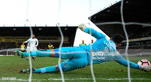 Oxford goalkeeper Simon Eastwood saves a penalty from Aleksander Mitrovic of Newcastle United during The Emirates FA Cup Fourth Round match between...