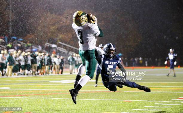 Oxford Hills' Alex Turner eludes Portland's Benjamin Stasium to make a touchown catch in the endzone on Friday during the Class A North football...