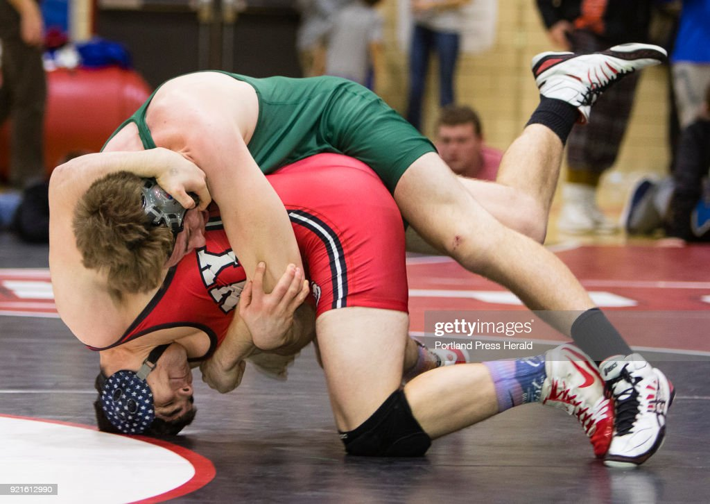 Oxford Hills Jeff Worster rolls over Conys Nic Mills in the 195 lb bout during the Class A state wrestling championship in Sanford, on Saturday, February 17, 2018. Conys Mills ended up on winning 7-1.