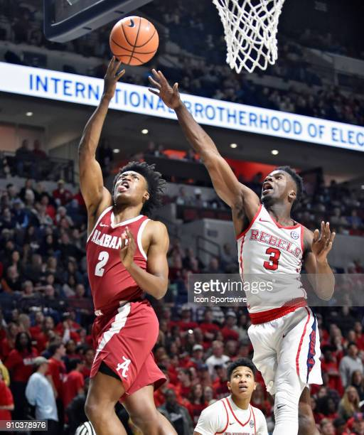 Alabama Crimson Tide guard Collin Sexton attempts a layup against Mississippi Rebels guard Terence Davis during the first half of the Ole Miss Rebels...