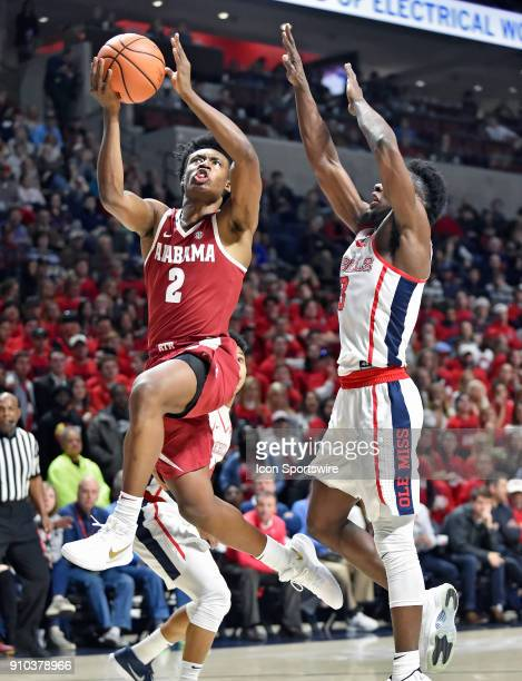 Alabama Crimson Tide guard Collin Sexton drives to the basket past a Mississippi Rebels defender during the first half of the Ole Miss Rebels game...