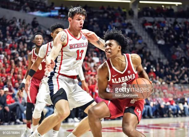Mississippi Rebels center Dominik Olejniczak defends Alabama Crimson Tide guard Collin Sexton under the basket during the first half of the Ole Miss...
