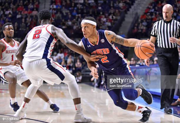 Auburn Tigers guard Bryce Brown rushes past a Mississippi Rebels defender during the first half of a college basketball game at The Pavilion in...