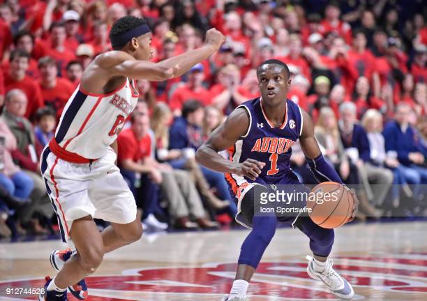 Auburn Tigers guard Jared Harper looks to get past a Mississippi Rebels defender during the first half of a college basketball game at The Pavilion...