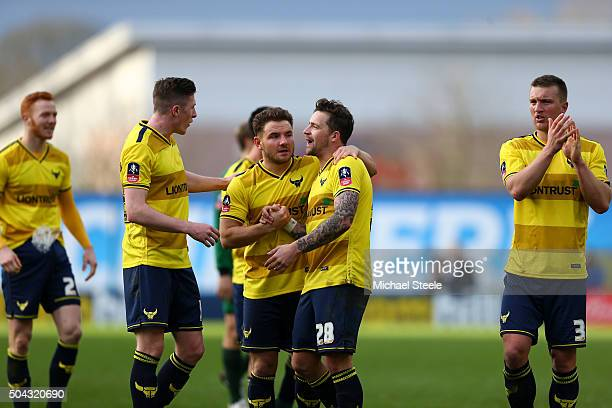 Oxford players celebrate following their team's 32 victory during The Emirates FA Cup third round match between Oxford United and Swansea City at the...