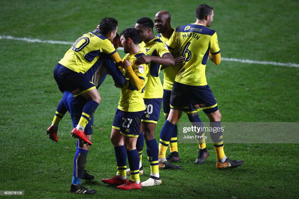 Oxford players celebrate with goalkeeper Scott Shearer after making some saves in the penalty shoot out after the final score at 90 minutes was 1-1 during the EFL Checkatrade Trophy Third Round match between Charlton Athletic and Oxford United at The Valley on January 9, 2018 in London, England.