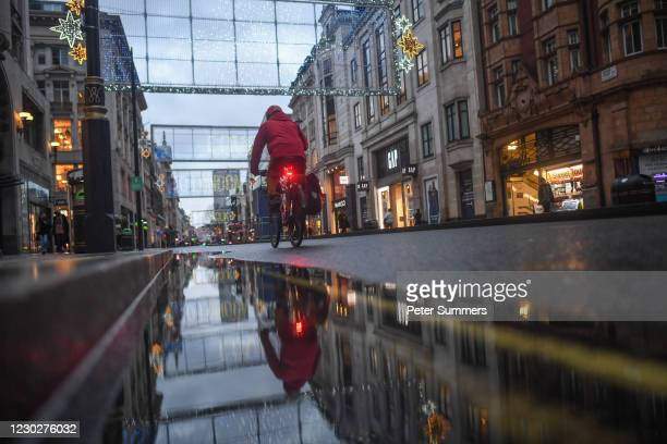 Oxford street is seen largely empty on December 23, 2020 in London, England. London and large parts of southern England were moved into a newly...
