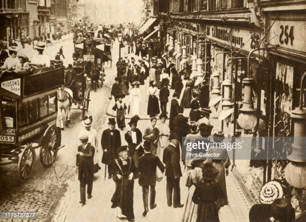 """Oxford Street' . View of horse-drawn buses and pedestrians in the busy shopping area of Oxford Street, London. From """"The Pageant of the Century""""...."""