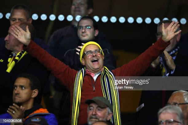 Oxford United fan Timmy Mallett enjoys the atmosphere during the Carabao Cup Third Round match between Oxford United and Manchester City at Kassam...