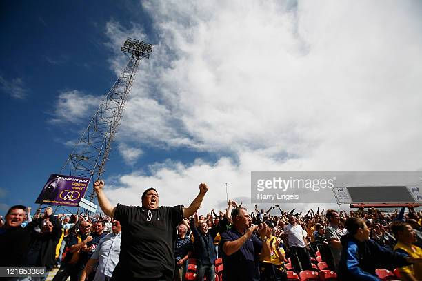 Oxford United fans celebrate after their team scored a goal during the npower League Two match between Swindon Town FC and Oxford United at the...