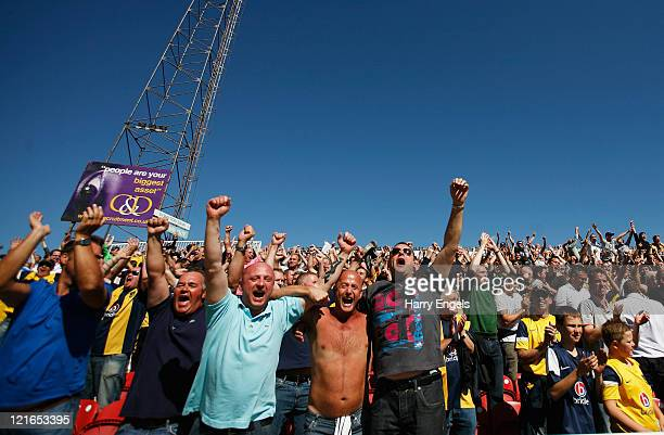 Oxford United fans celebrate winning the match following the npower League Two match between Swindon Town FC and Oxford United at the County Ground...