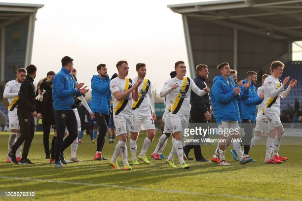 Oxford United players celebrate at full time of the Sky Bet League One match between Shrewsbury Town and Oxford United at Montgomery Waters Meadow on...