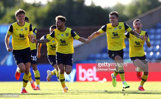 Oxford United players celebrate their penalty shootout victory in the Sky Bet League One Play Off Semifinal 2nd Leg match between Oxford United and...