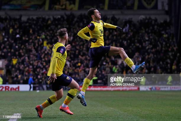 Oxford United's English striker Nathan Holland celebrates after scoring their late equalizer during the FA Cup fourth round replay football match...