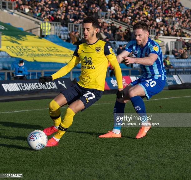 Oxford United's Nathan Holland under pressure from Blackpool's Oliver Turton during the Sky Bet League One match between Oxford United and Blackpool...