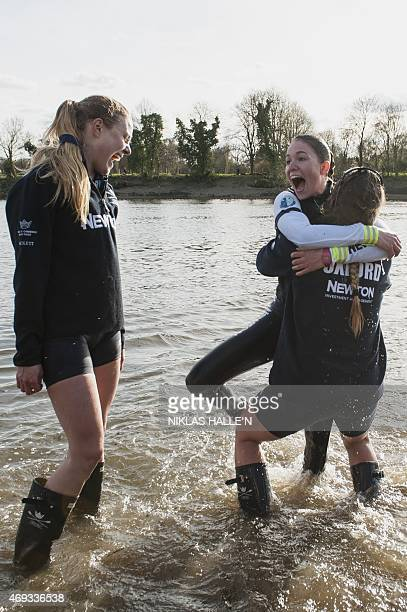 Oxford University cox Jennifer Her smiles after being thrown into the water by her team after beating the Cambridge University in the boat race on...
