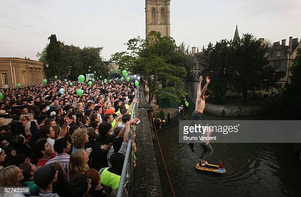 Oxford University students jump into the river from Magdalen Bridge to celebrate May Day on May 1 2005 in Oxford England Police have tried in past...