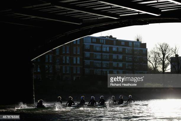 Oxford's 'Boudicca' crew pass under Barnes Bridge on their way to victory over 'Cleopatra' during the Women's University Boat Race Trial 8's race on...