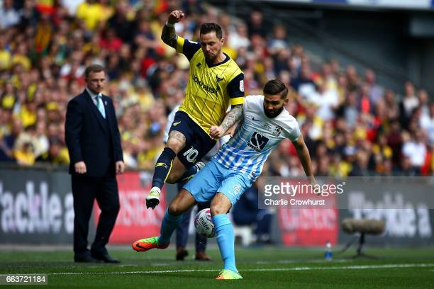 Oxford's Chris Maguire battles for the ball with Coventry's Jordan Turnball during the EFL Checkatrade Trophy Final between Coventry City and Oxford...