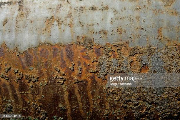 oxide texture in a military cannon - arrugginito foto e immagini stock